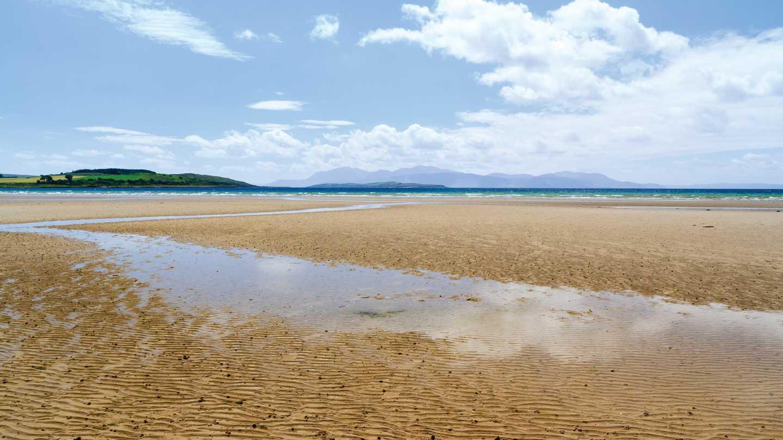 The sandy coastal Ettrick Bay