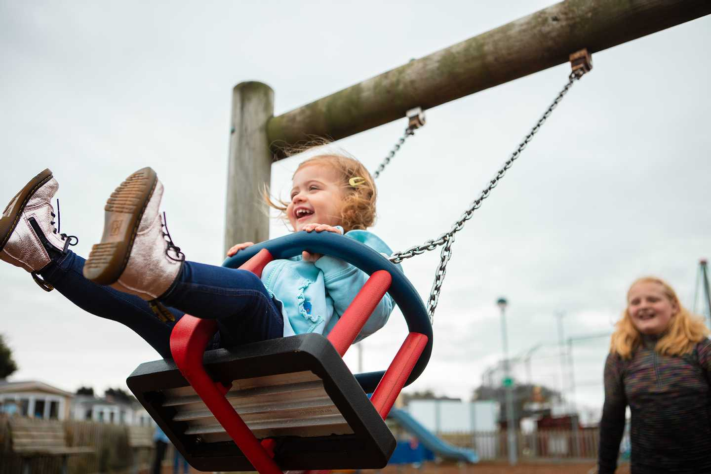 Little girl in the outdoor play area