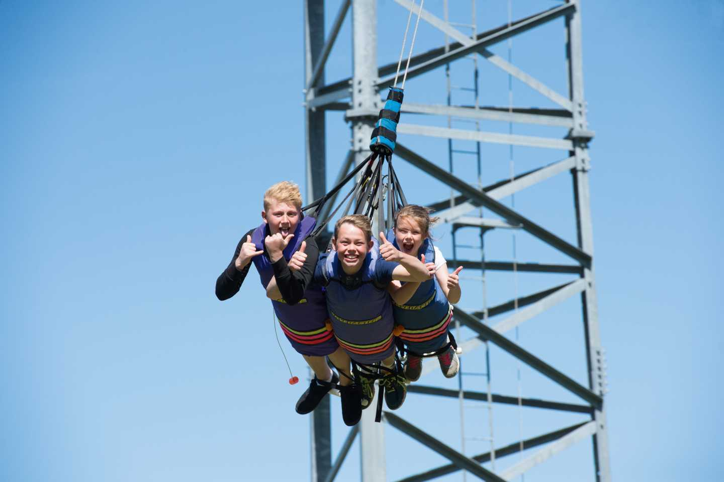 3 Children on a sky swing