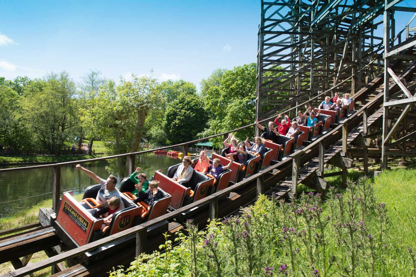 Guests on a rollercoaster at Oakwood Theme Park