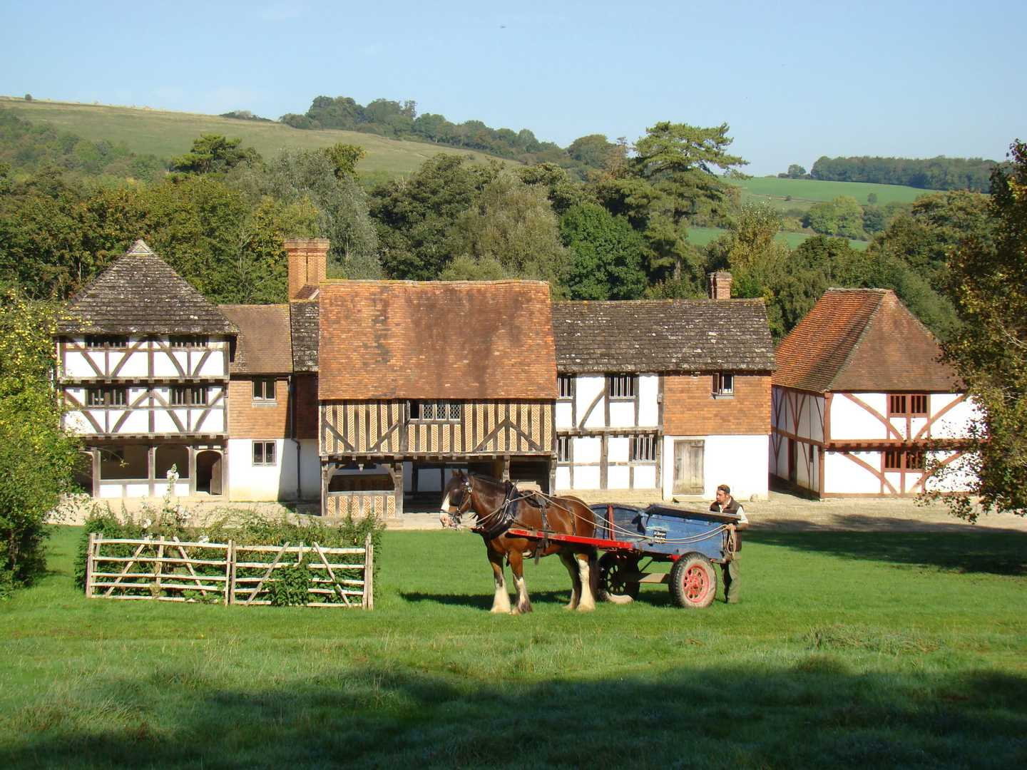 Horse and cart in front of rural historic buildings