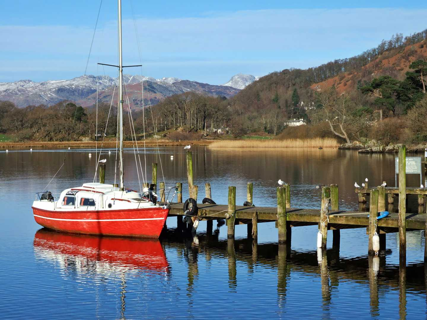 A red and white boat on Lake Windermere