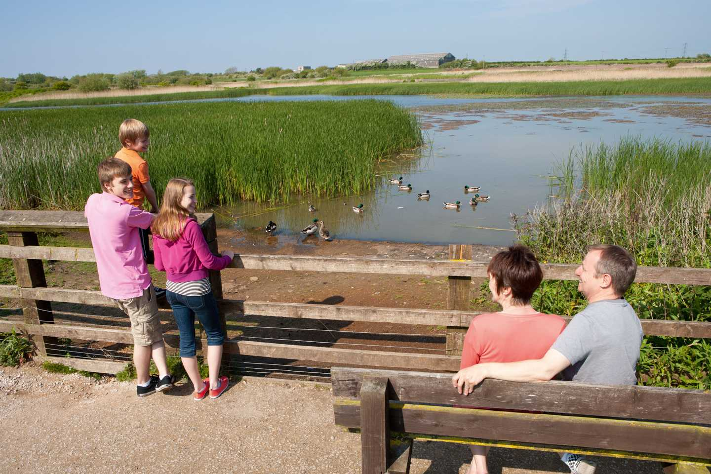 Guests relaxing by the mere at Marton Mere