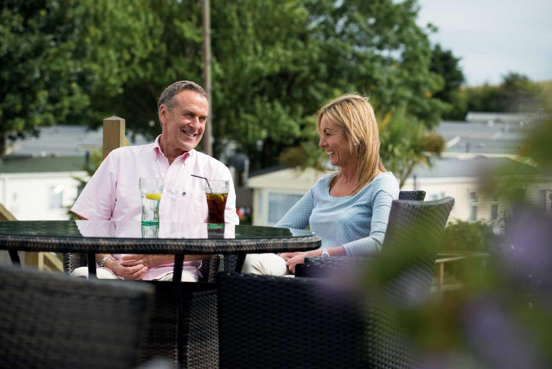 A couple sitting on the Café Bar terrace