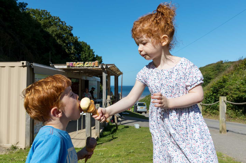 Children eating an ice cream from the beach café
