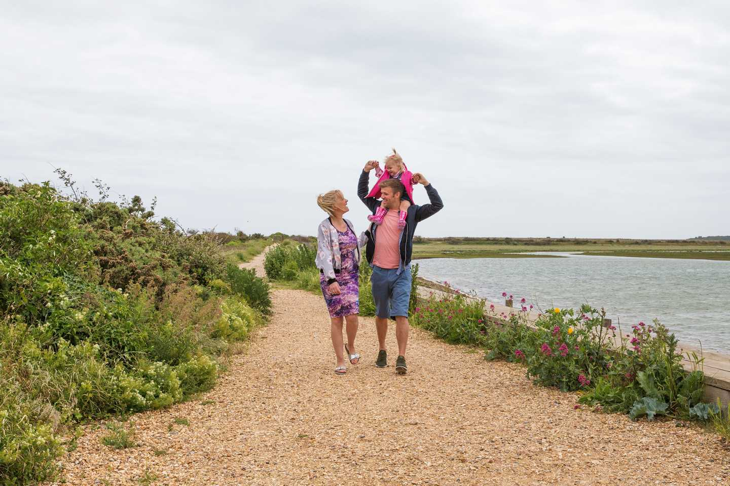Guests walking beside the lagoon at Church Farm