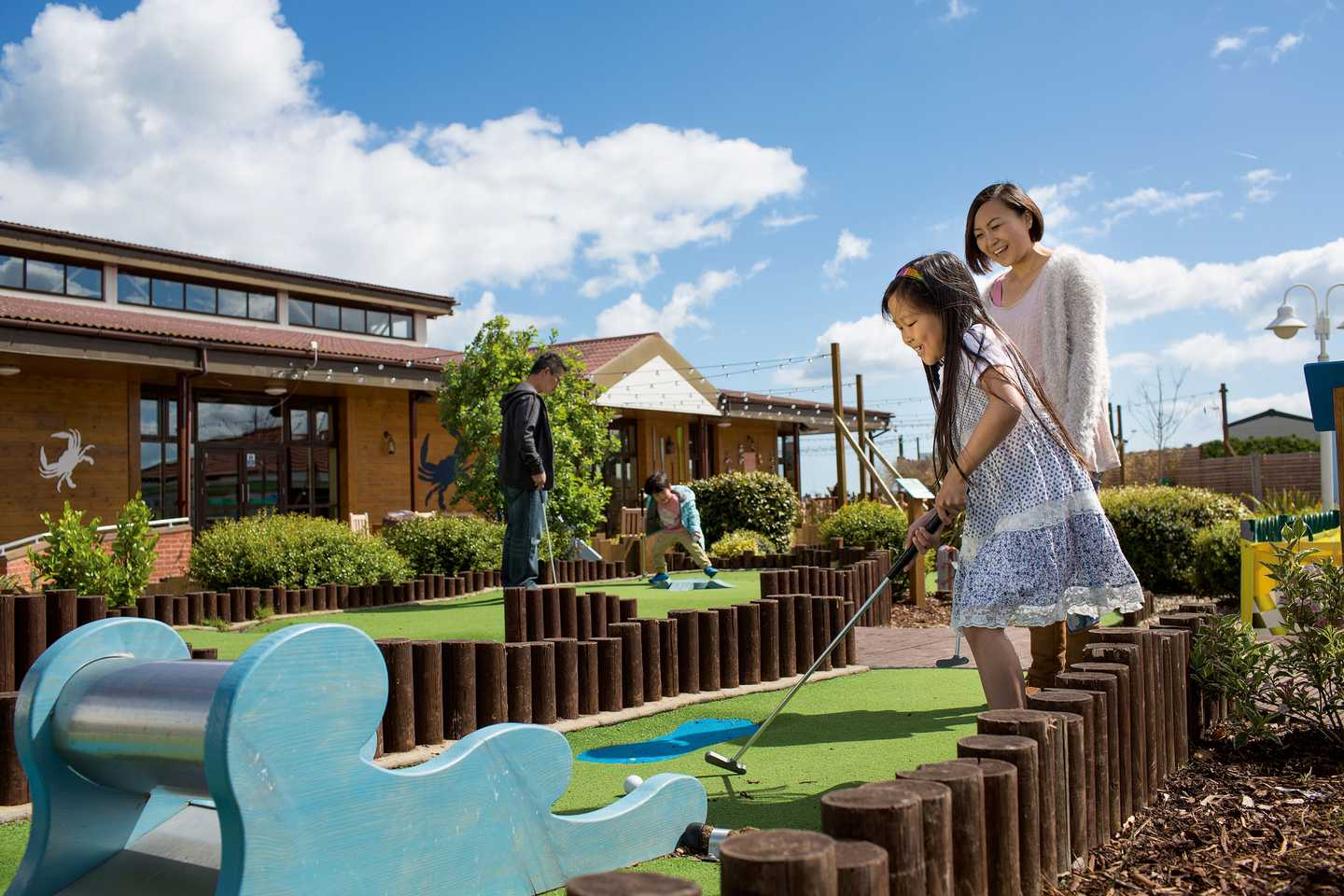 Guests playing on the adventure golf course