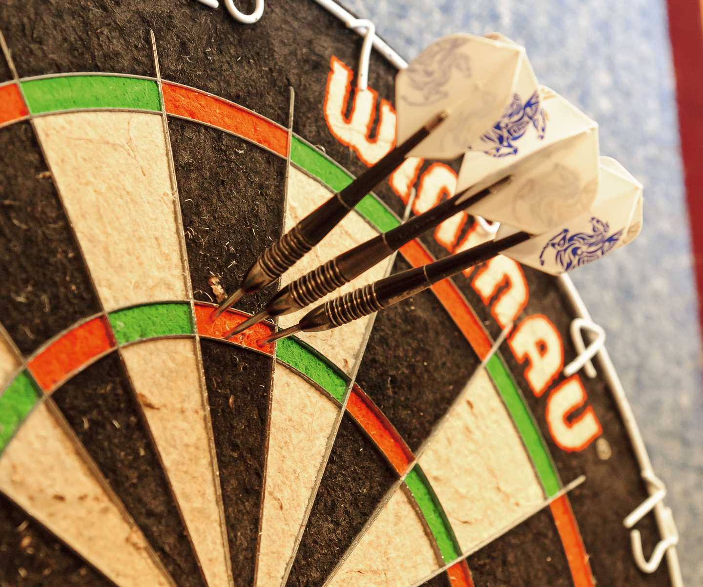 Three darts on a dart board