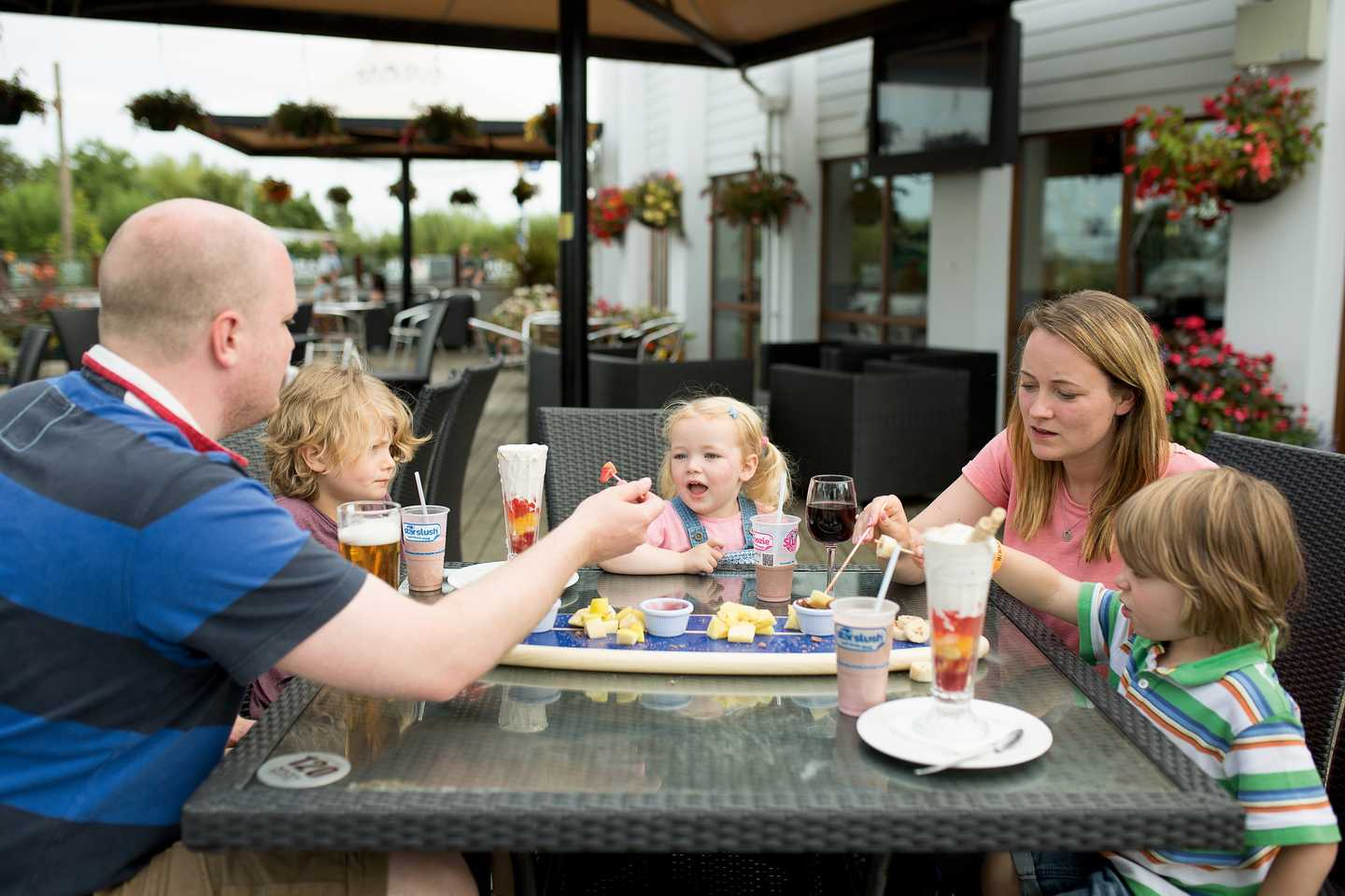 Family enjoying a meal on the Mash and Barrel terrace