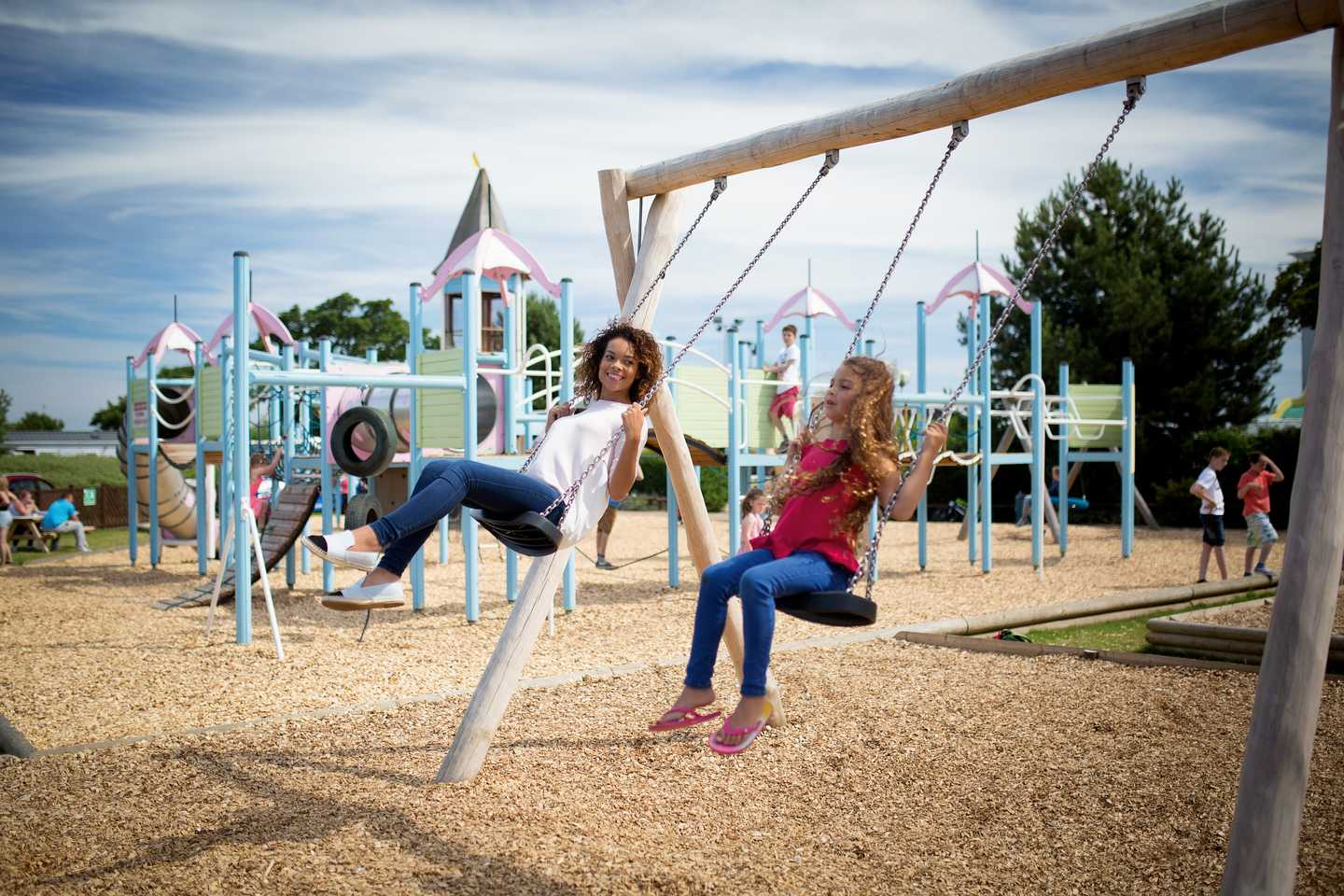 Guests swinging in the outdoor play area