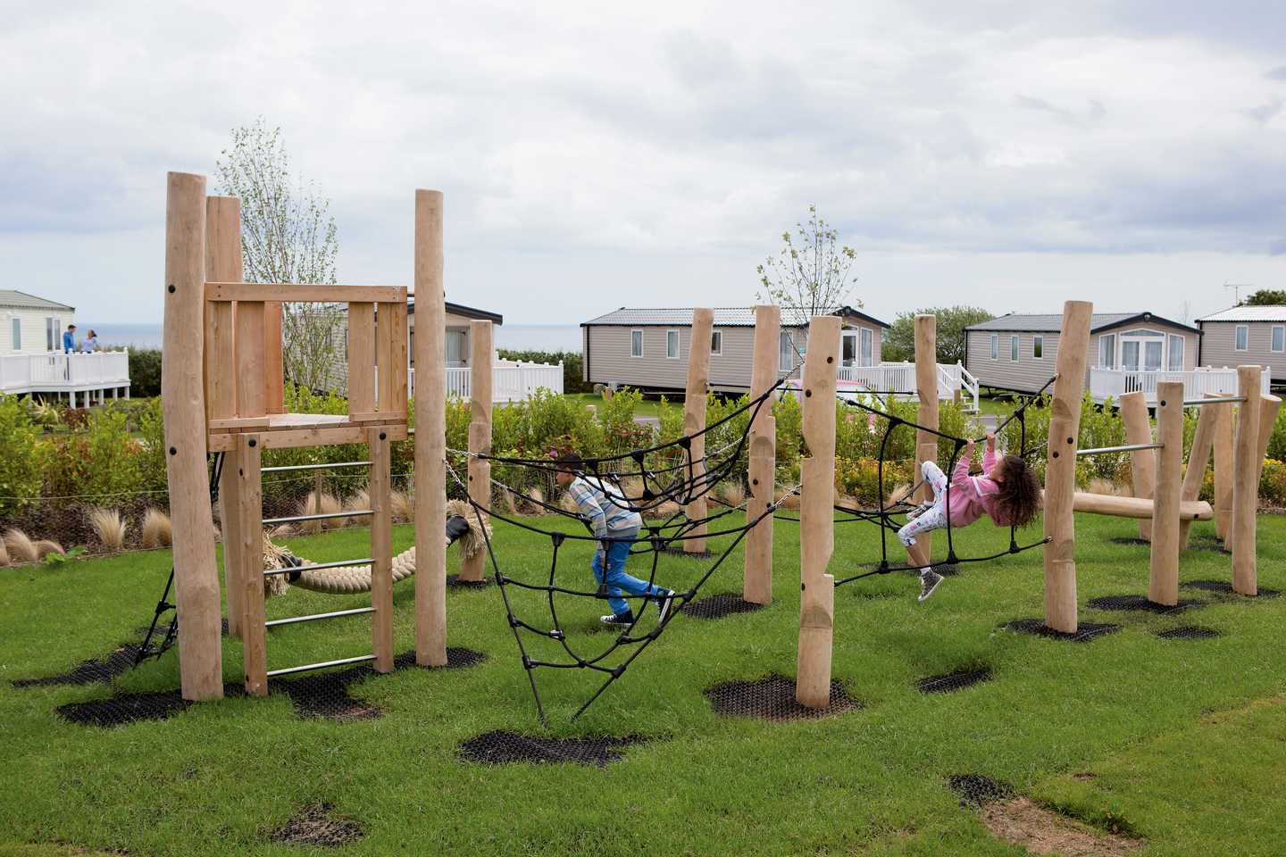 Children climbing on our outdoor play area