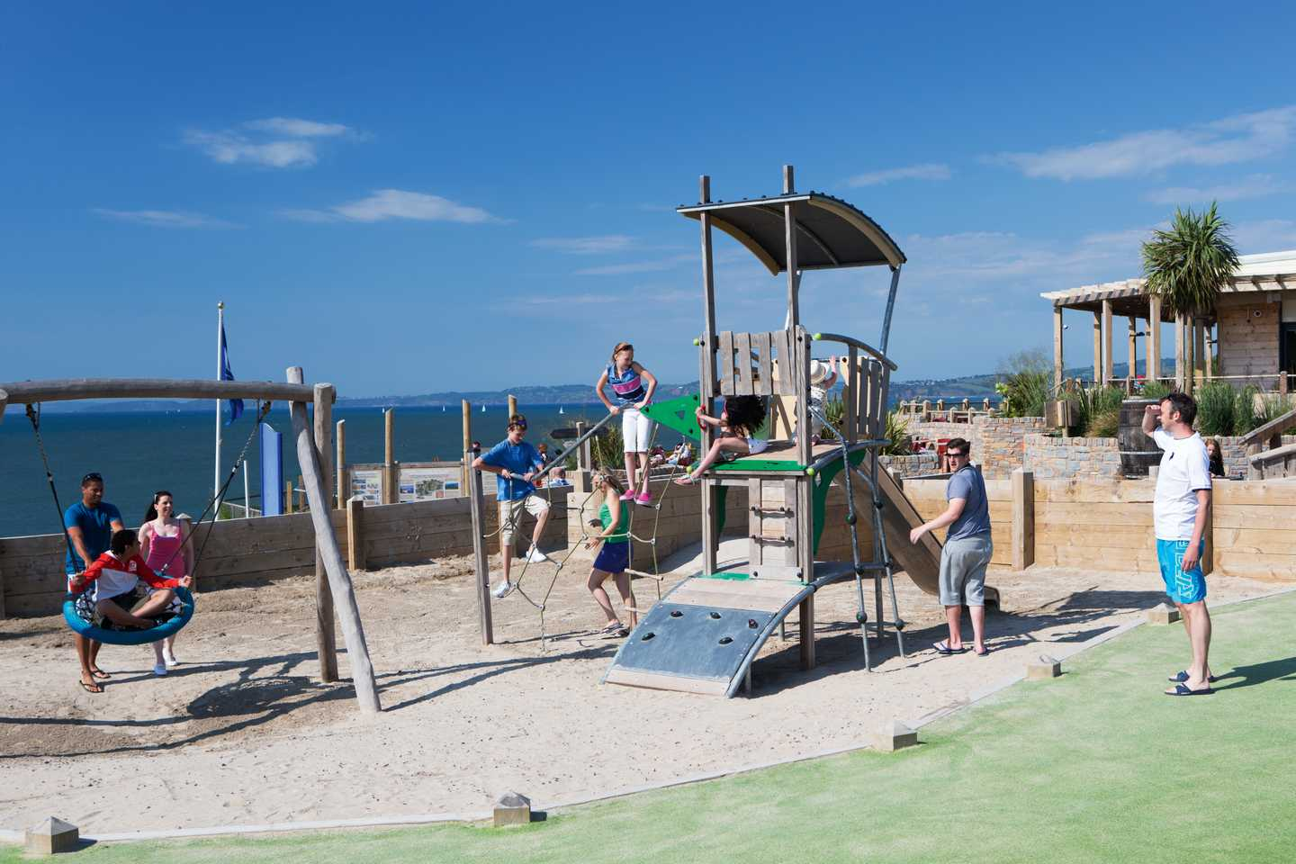 Children playing in the outdoor play area with stunning sea views