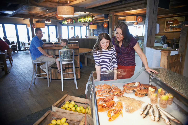 Guests choosing their fresh seafood inside our South Beach café