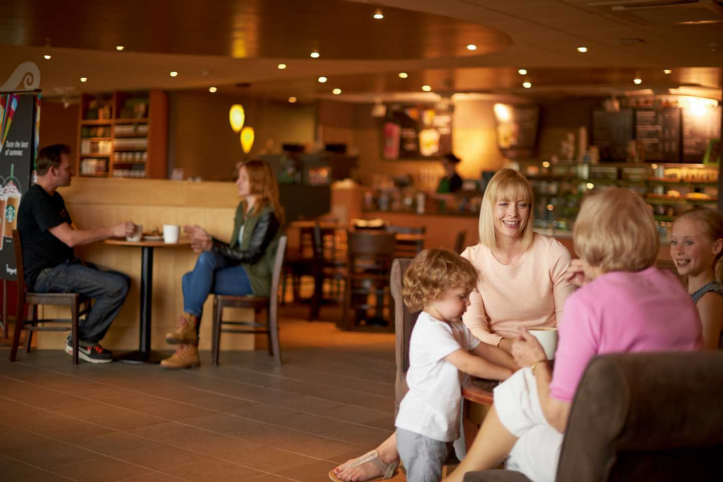 Guests enjoying a coffee in our Starbucks coffeehouse