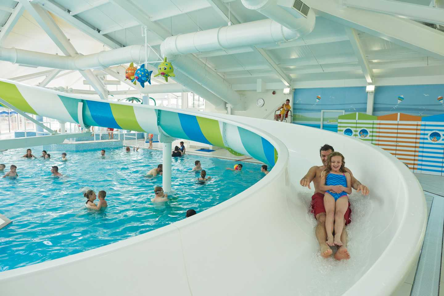 Family enjoying the indoor pool and water flume