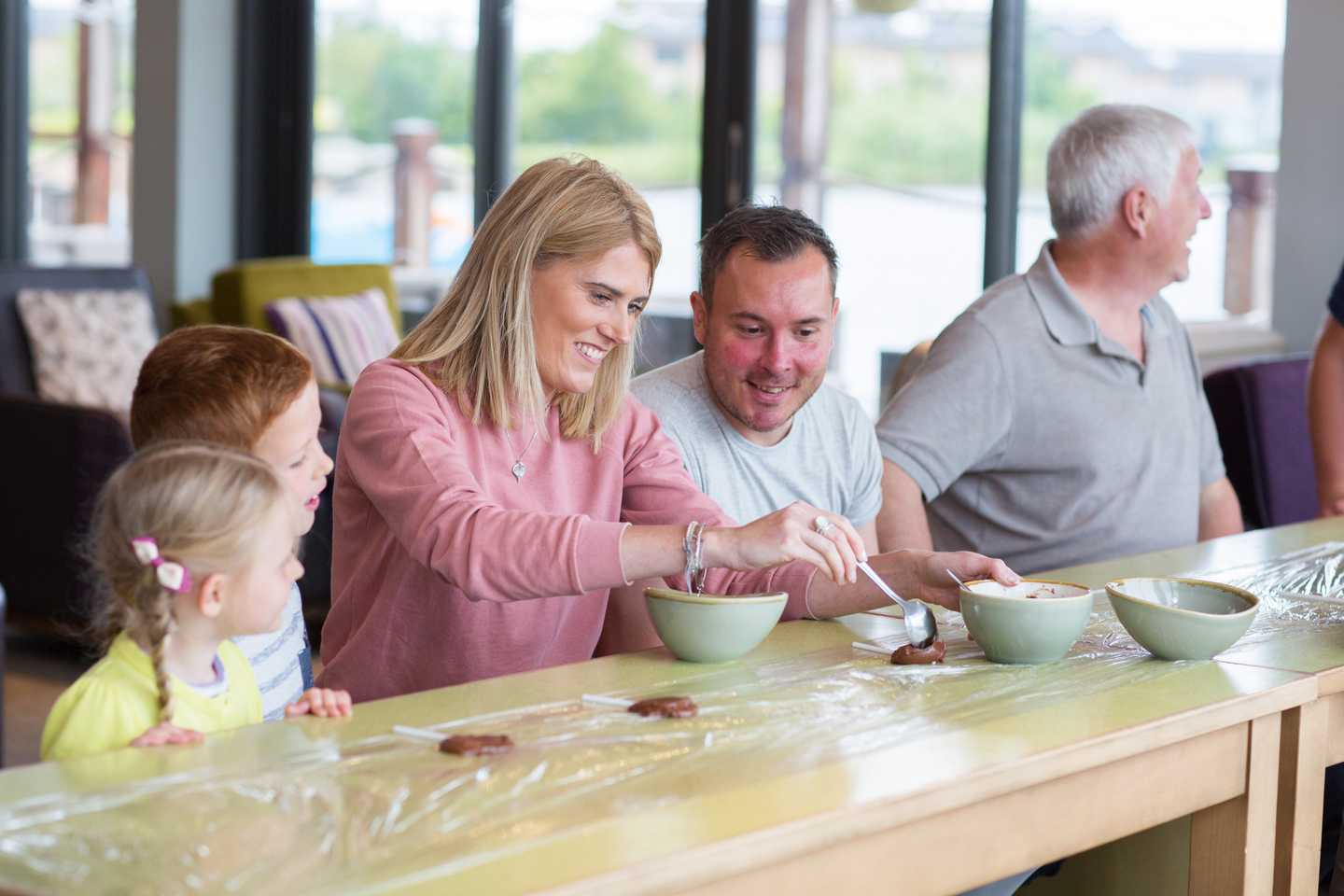 Family having a go at making chocolate