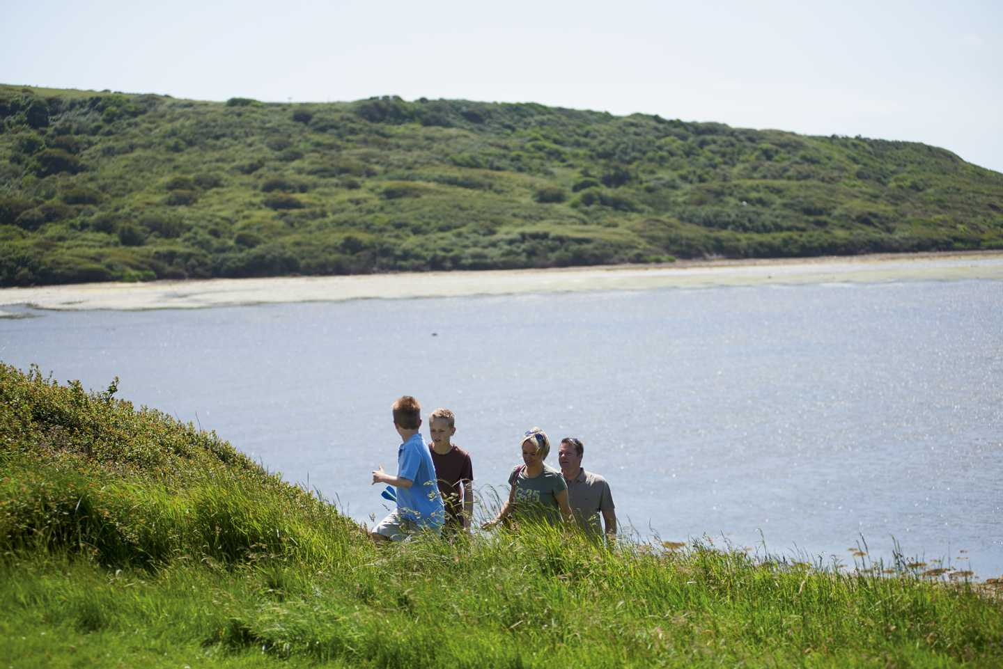 Family walking along the cliff top at Littlesea