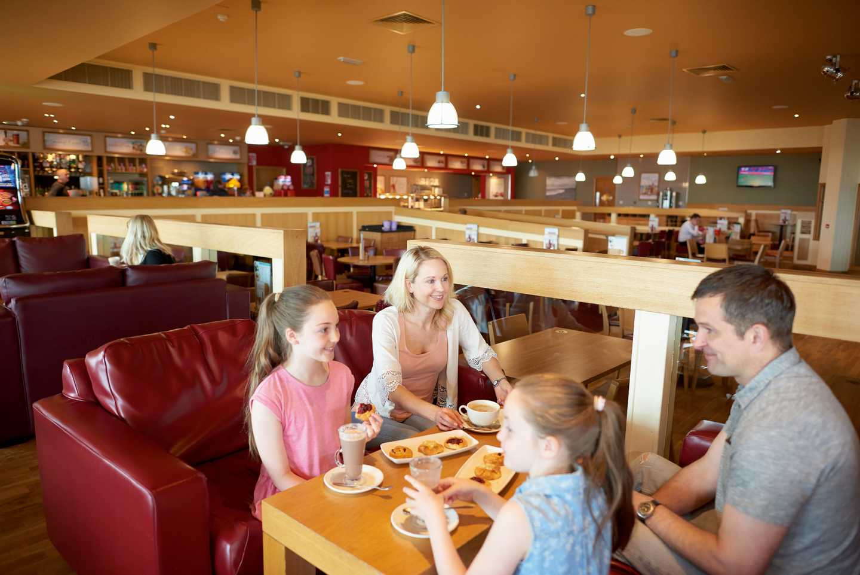 Guests enjoying a meal at the Mash and Barrel bar and restaurant
