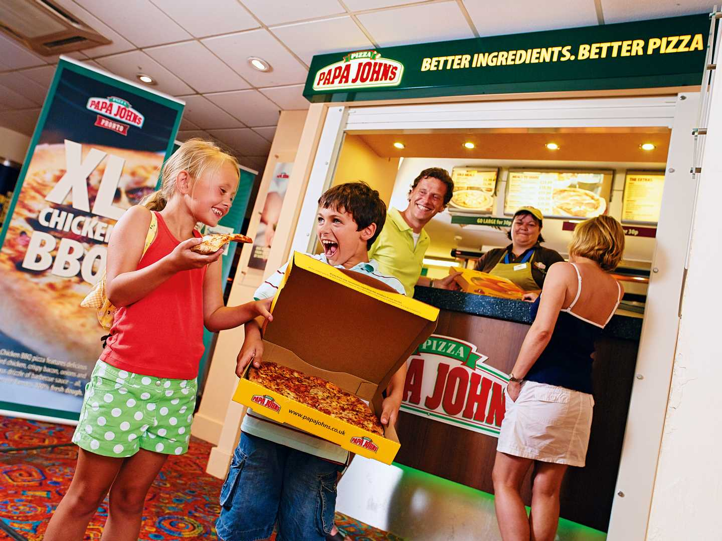 Family eating pizza from the Papa Johns takeaway