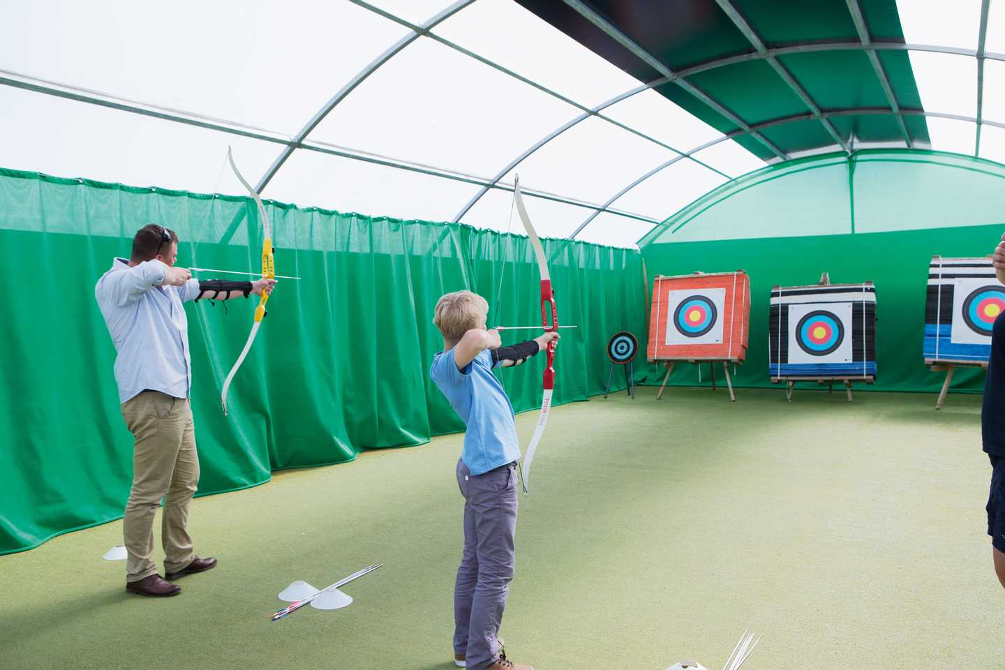 Guests playing indoor archery