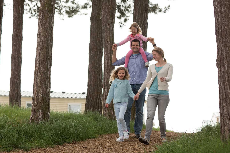 Family enjoying a stroll along the park walk