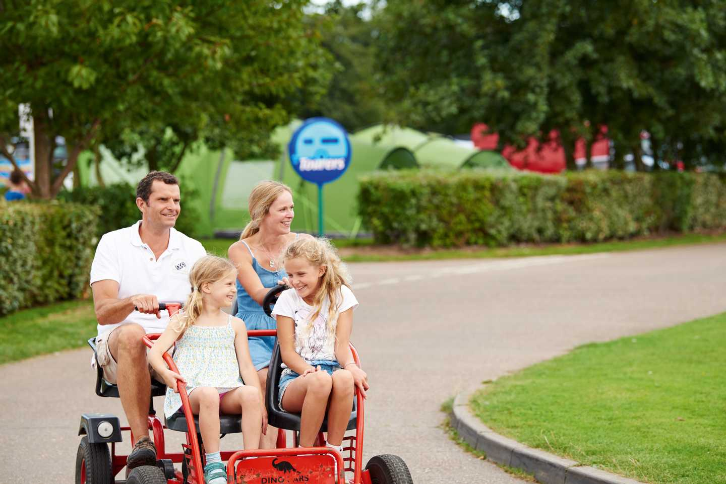 Family touring the park on a hired kart