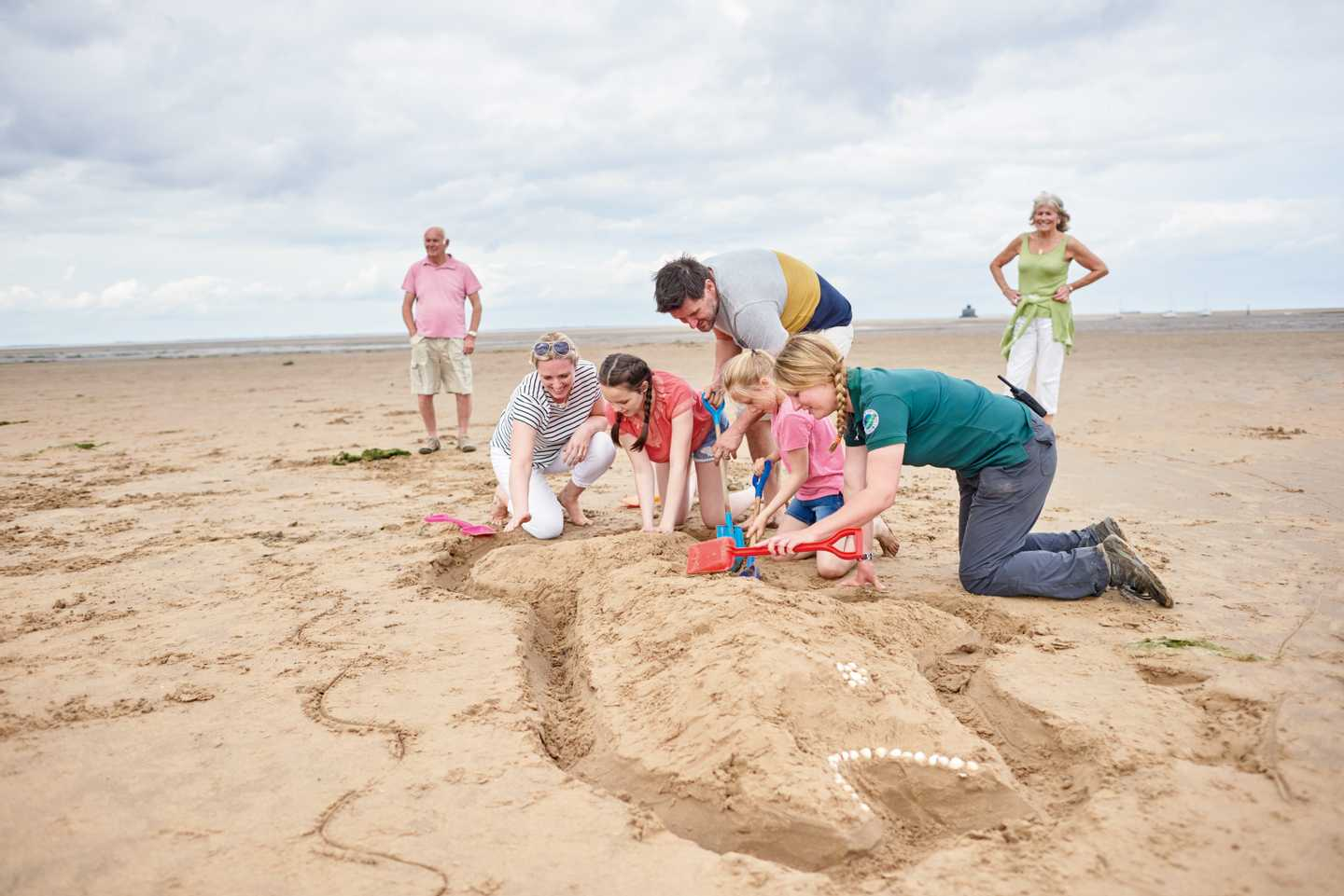 Children with a Ranger on the beach at our Nature Rockz sand sculptures activity