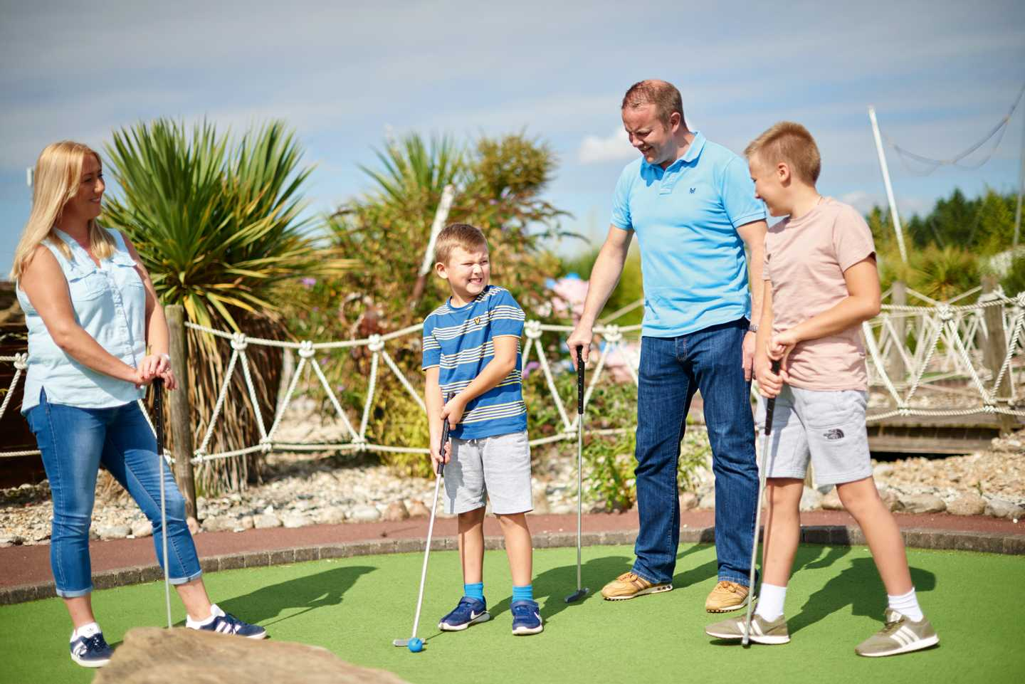 Family playing on the adventure golf course at Thorpe Park