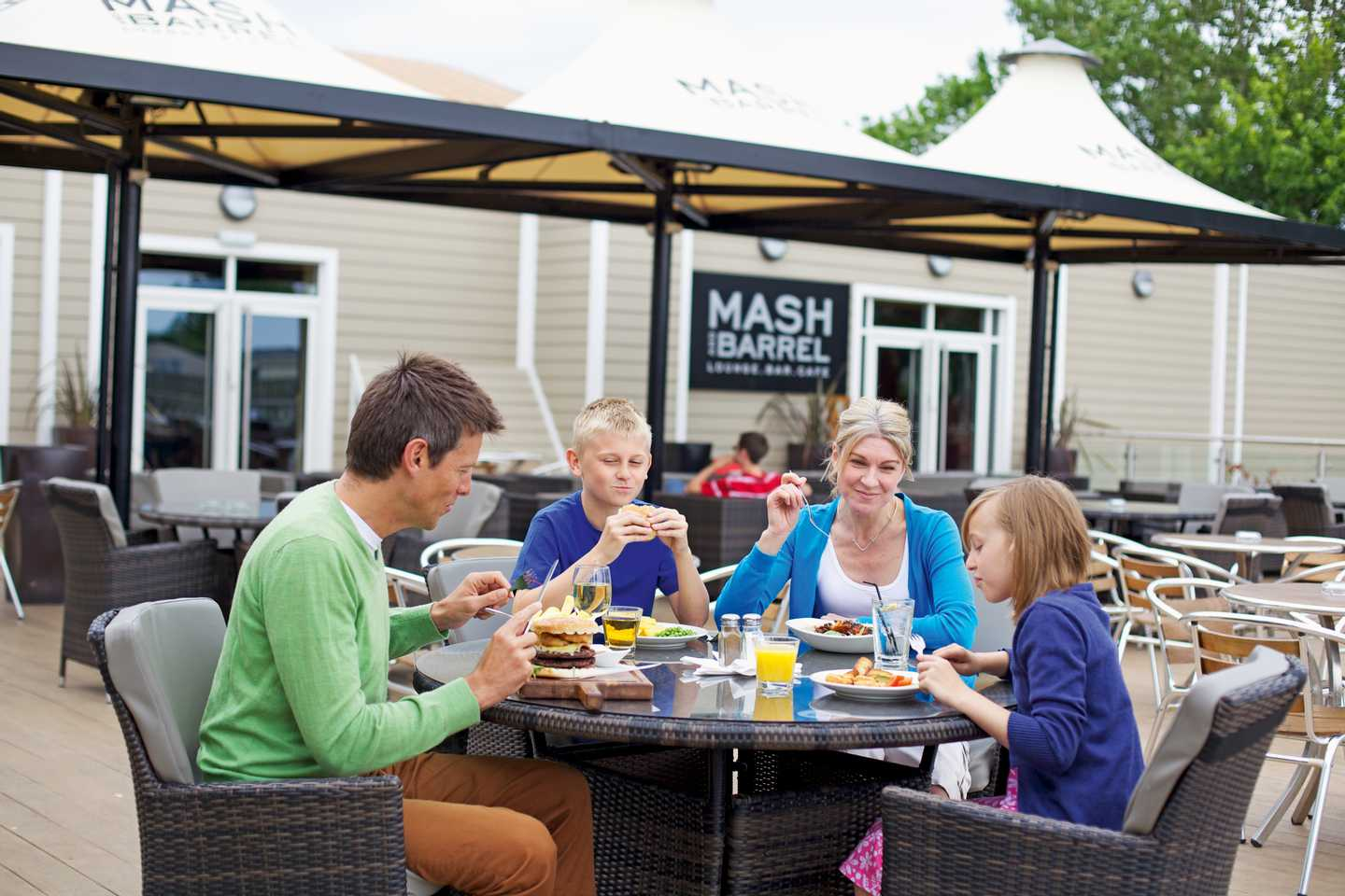 Guests eating on the Mash and Barrel terrace