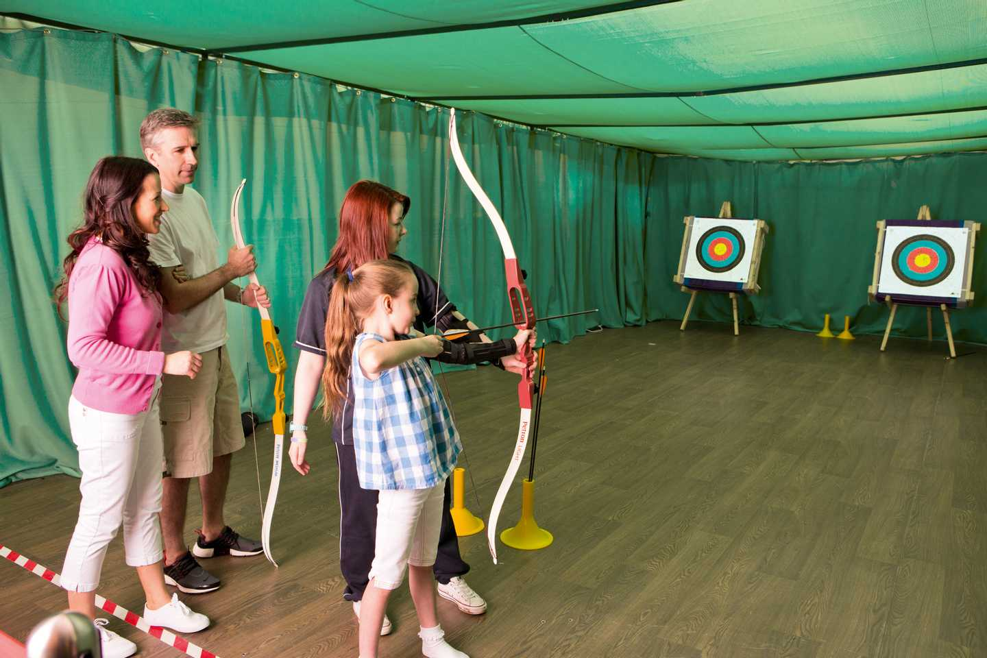 Family trying out archery