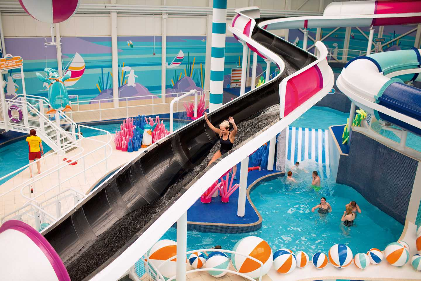Guest sliding down the indoor water flume