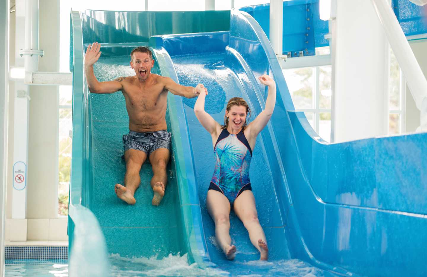 Guests whizzing down the water slide