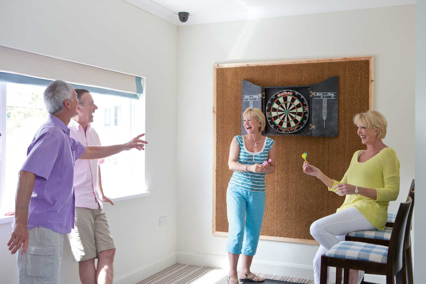 Guests playing darts in the Owners' Lounge