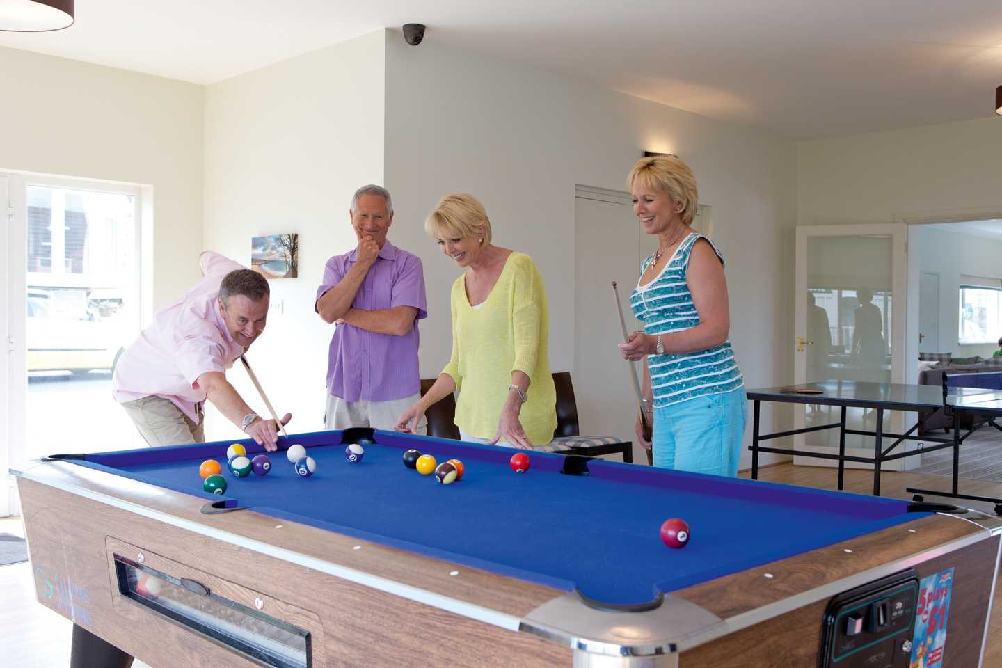 Guests playing pool in the Owners' Lounge