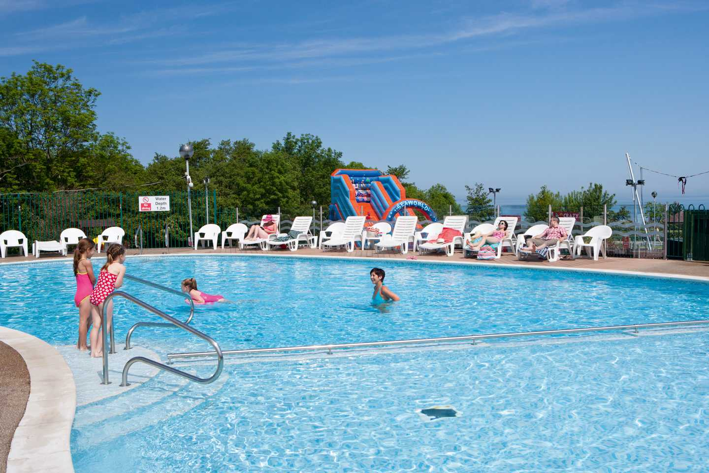 Guests playing in the outdoor pool at Quay West