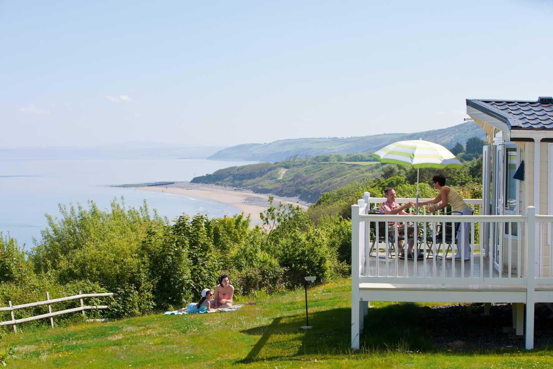 Owners on their veranda enjoying the sea view