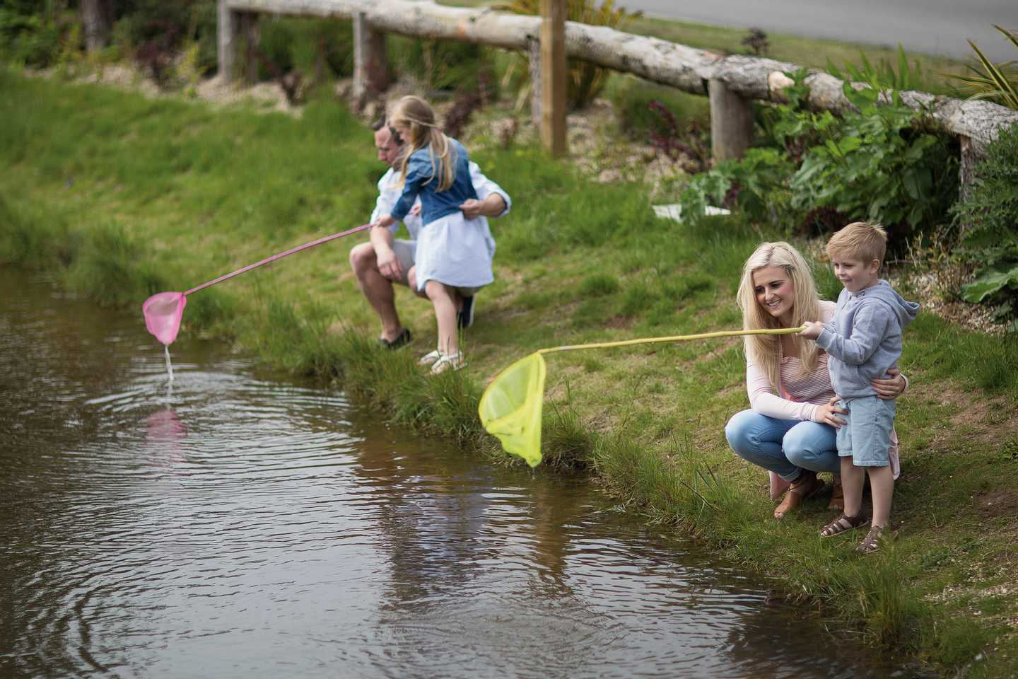 Family pond dipping with their fishing nets at our Nature Rockz activity