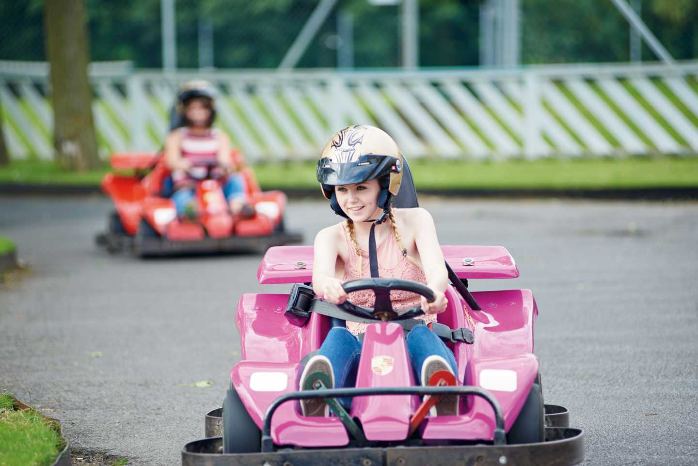 Children racing around the go-kart track