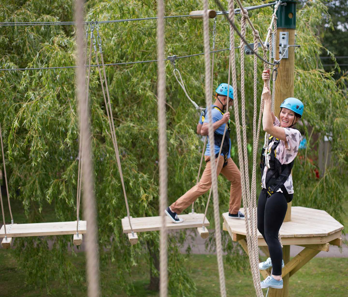 Guests climbing their way through the Aerial Adventure course