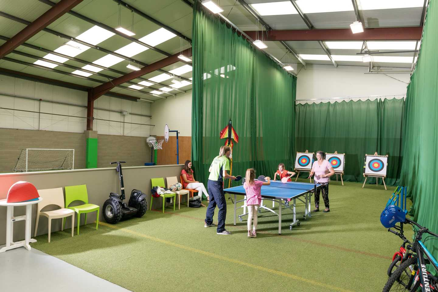 Guests playing ping pong in the all-weather Activity Barn