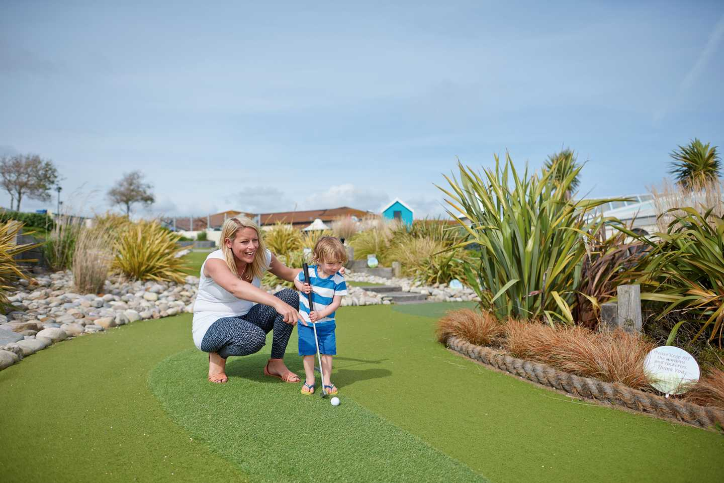 Family playing on the adventure golf course at Littlesea