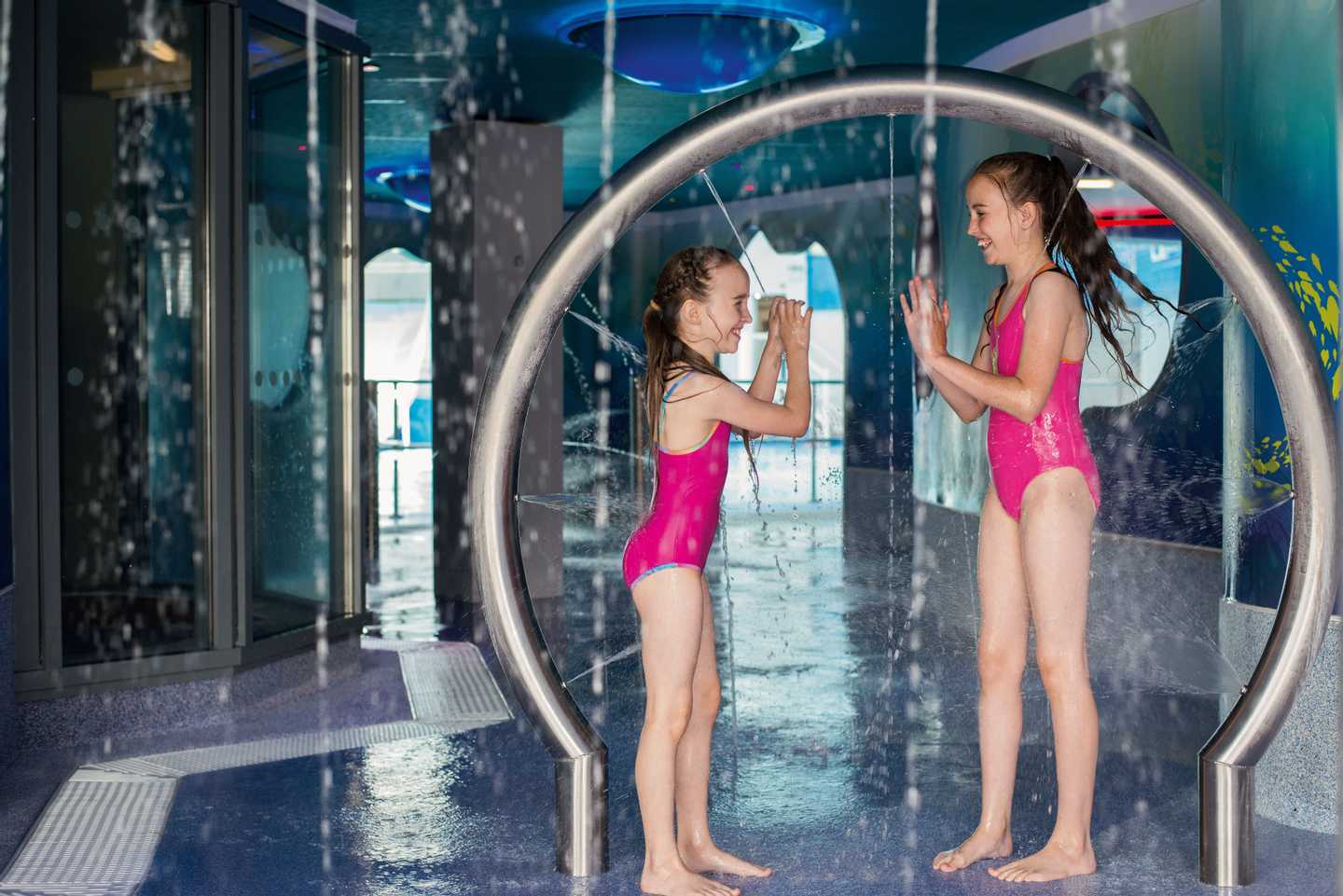 Girls playing games in the SplashZone grotto