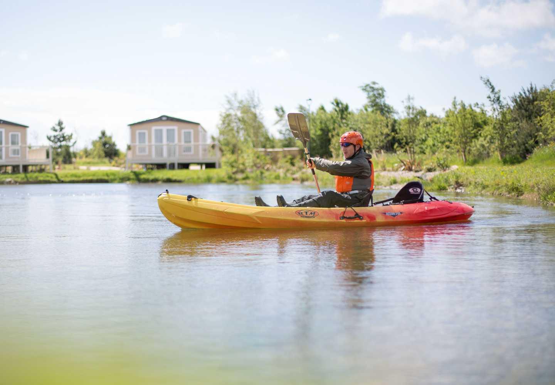 Guests kayaking on the lake