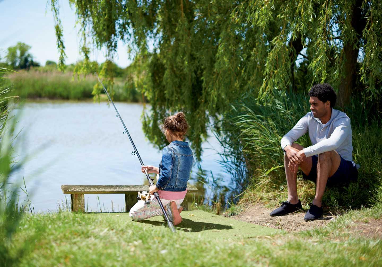 Guests fishing at the fishing lake
