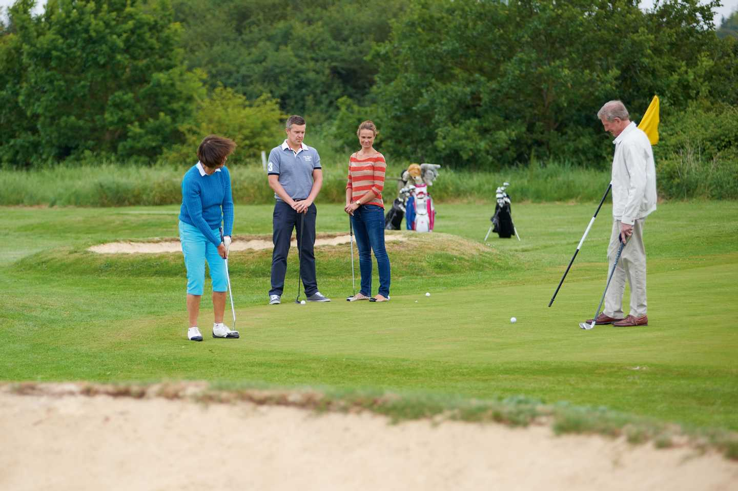 Family group playing golf