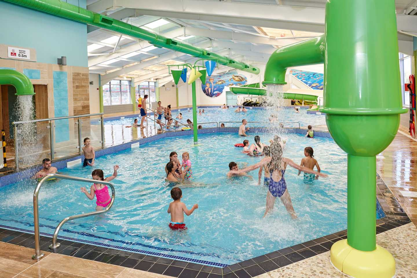 Families having fun in the heated indoor pool