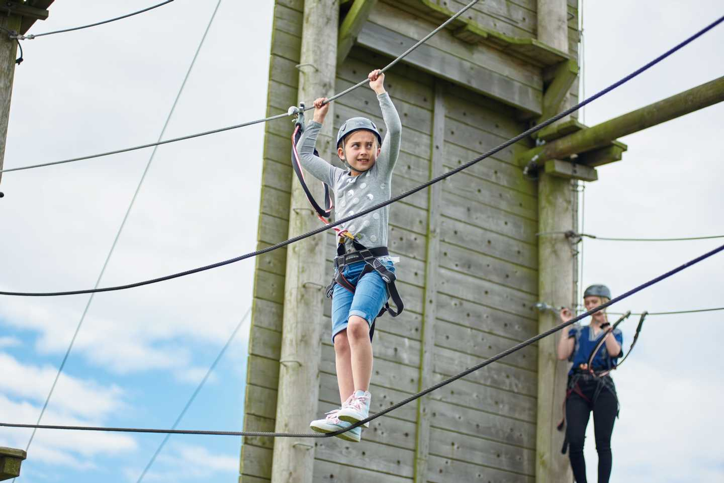 Child attempting the ropes course