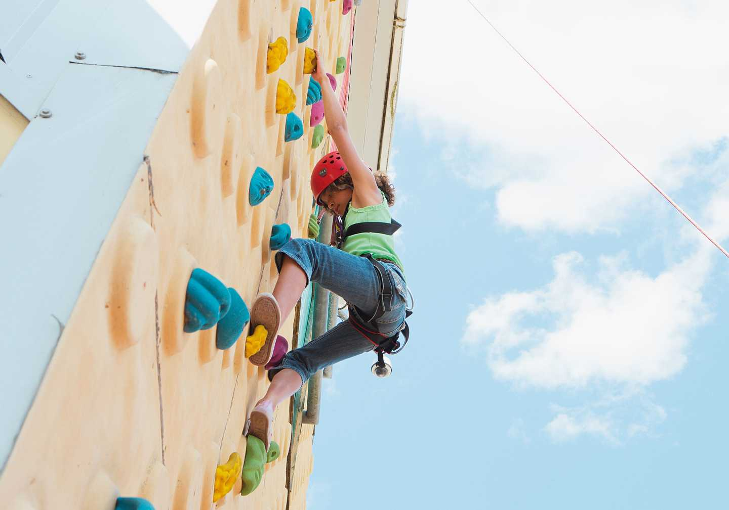 Guests climbing up the outdoor climbing wall
