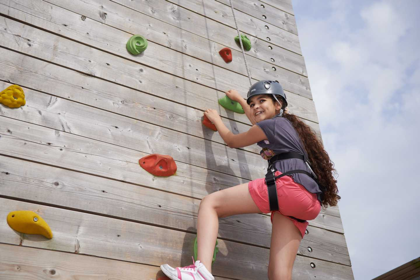 Guest attempting the outdoor climbing wall