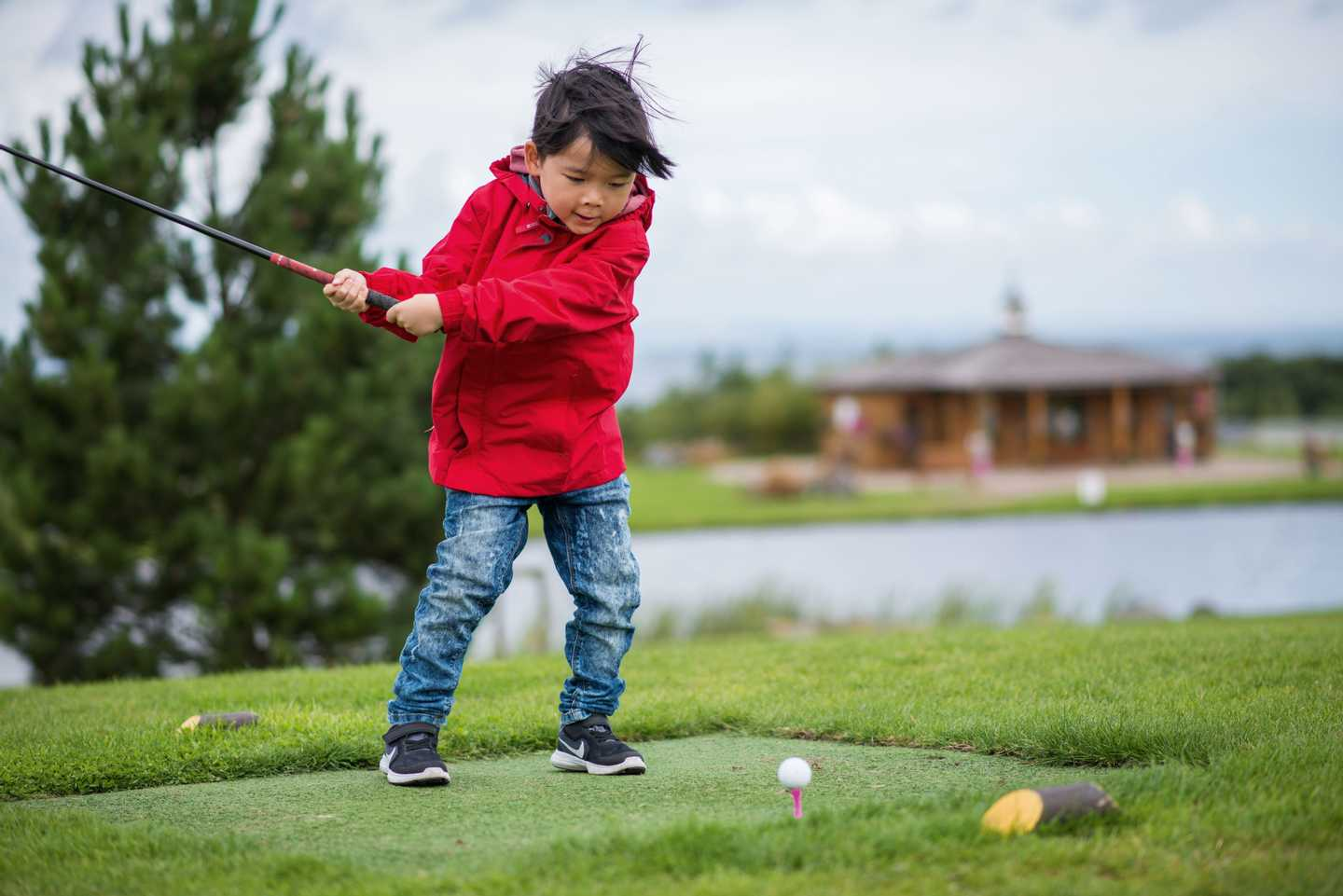 Child playing golf at 9-hole golf course